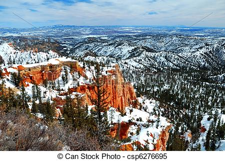 Stock Images of Bryce canyon panorama with snow in Winter with red.