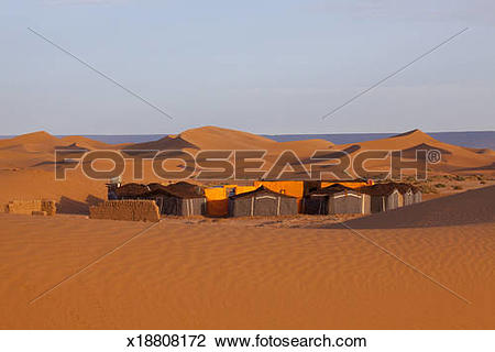 Stock Photo of Bedouin camp site in the desert, red sand dunes.
