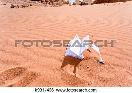 Stock Images of notebook in red sand dune of dessert k9317436.