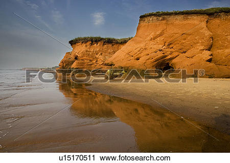 Stock Photography of Red shoreline and sculpted cliffs on Iles de.