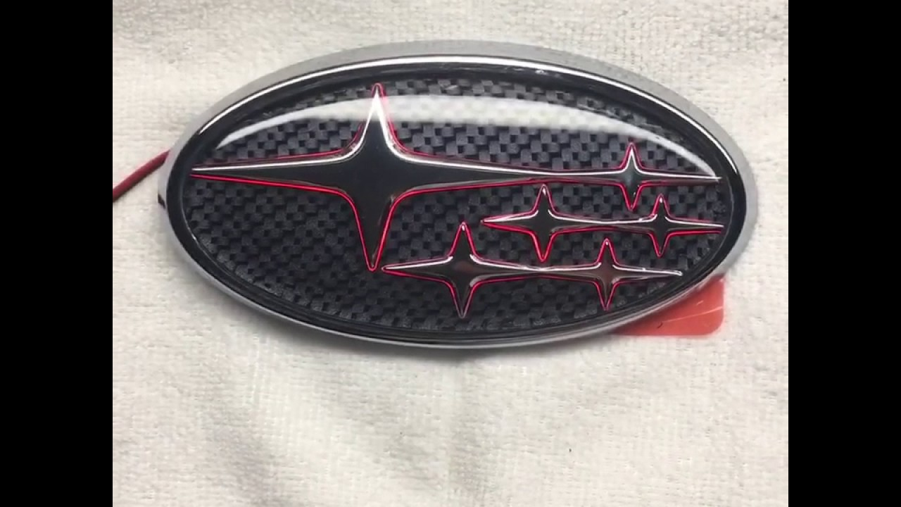 Carbonfiber background with red LED rear Subaru emblem.