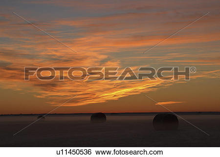 Stock Images of lighting, clouds, sun, morning, predawn, reddish.