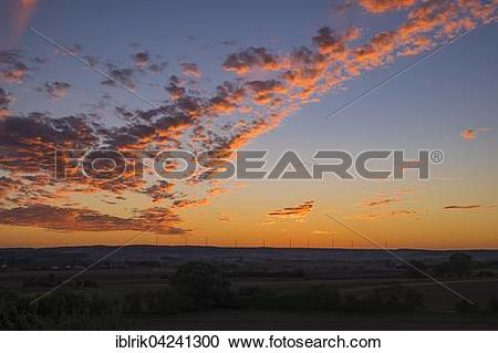 Stock Photography of Clouds illuminated red at sunset, reddish.