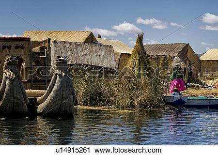 Stock Photography of Lake Titicaca: islands of Uros with family on.