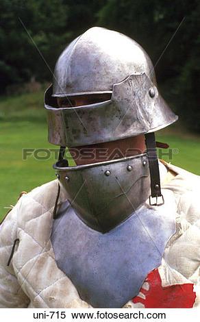 Stock Image of Battle Reenactor in Medieval Steel Helmet uni.