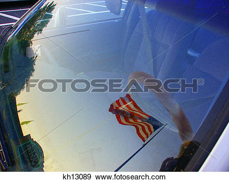 Stock Photograph of U.S. Flag Reflected In Car Window Patriotic.