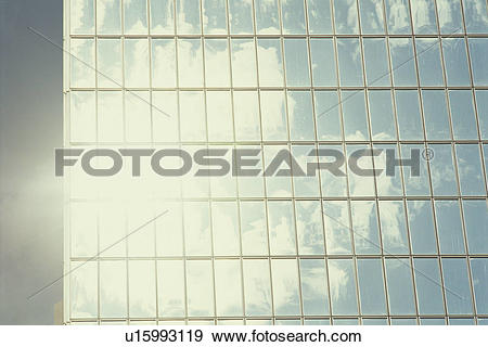 Stock Photograph of The Sky Reflected In The Window Of A Building.