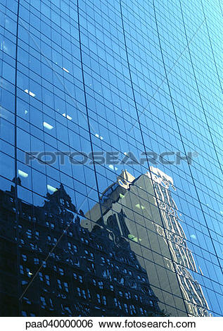 Stock Images of Buildings reflected in window panes of skyscraper.