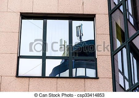 Stock Images of mobile stations reflected in window.