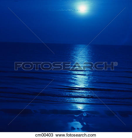 Stock Photo of Moon And Moonlight Reflecting On Dark Blue Ocean.