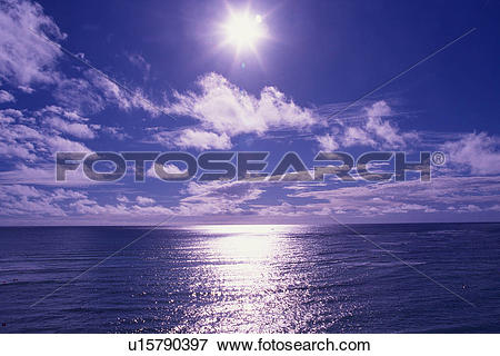 Picture of the Sun Shining Brightly, the Ocean Reflecting Its.