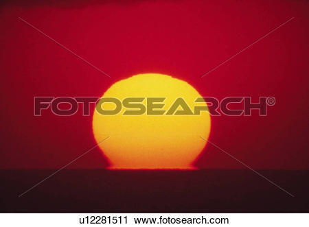 Stock Photography of the Sun By Sunset at Sea, the Sky Reflecting.