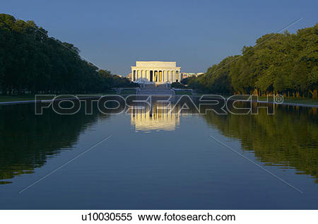 Stock Image of The Lincoln Memorial and Reflecting pond at sunrise.