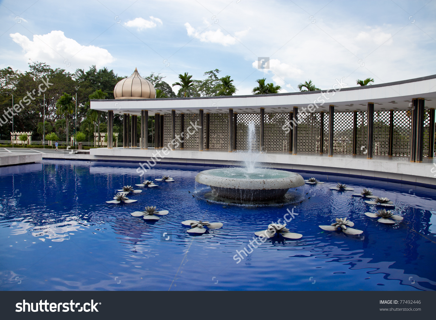 A Long Rectangular Reflecting Pool With Fountain Stock Photo.
