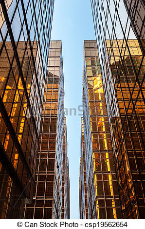 Stock Images of Symmetrical glass skyscrapers reflecting sunlight.