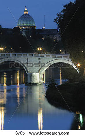 Stock Photography of Reflection of church and bridge in water.