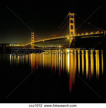 Stock Photo of Golden Gate Bridge brightly illuminated at night.