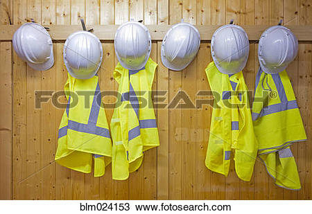 Stock Photo of Hard hats and safety vests with reflective stripes.