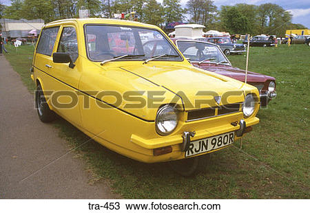 Stock Photo of Yellow Reliant Robin Three Wheeled Car tra.