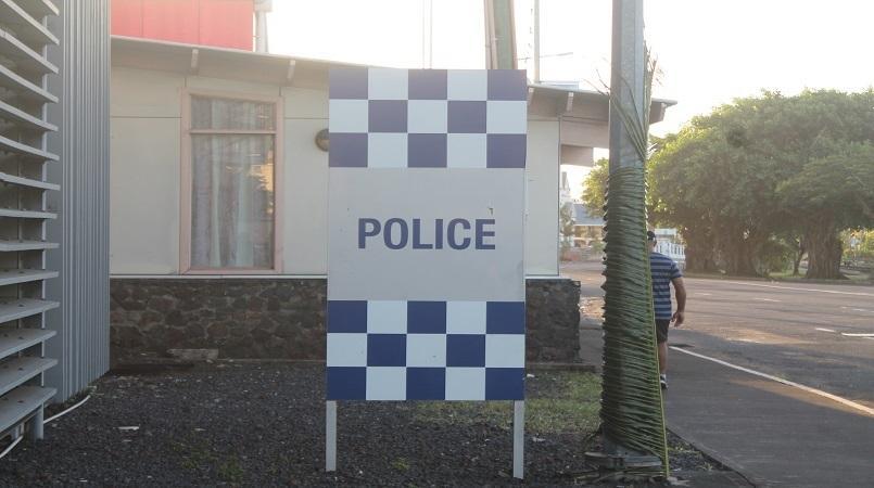 Fraud detectives arrest former PNG Registrar of Companies.