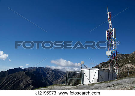 Stock Photo of mobile phone relay station on top of a mountain.