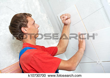 Stock Photography of tiler at home renovation work k10730700.