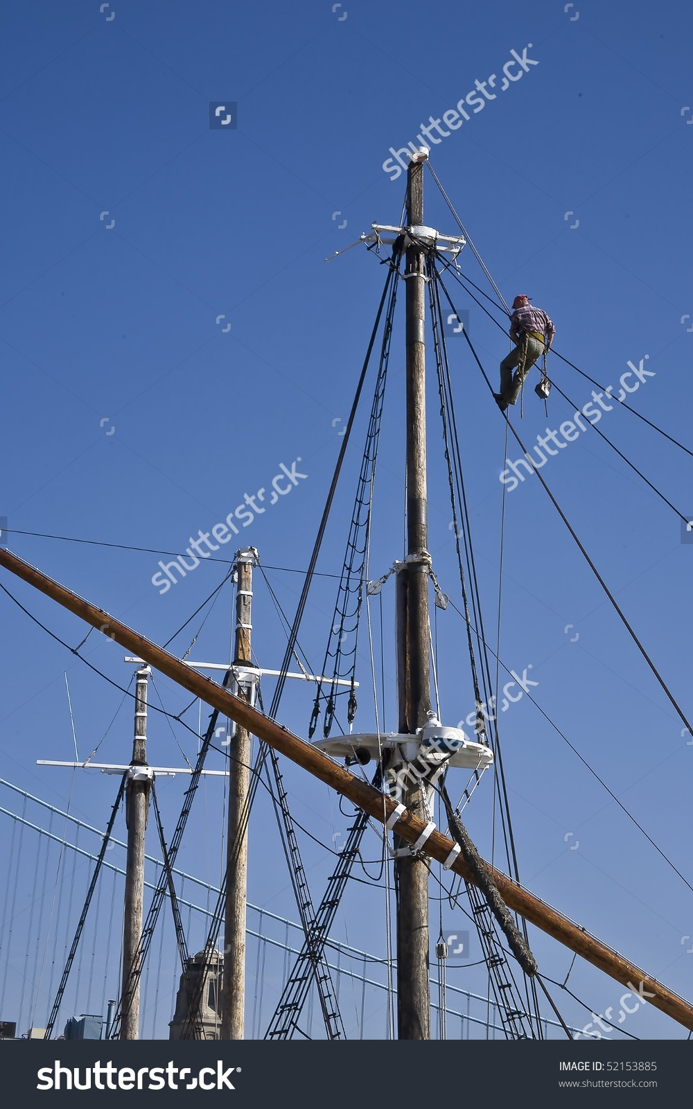 Man Suspended In A Bosun'S Chair Repairing The Rigging Of An Old.