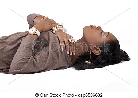 Stock Photo of Young African American Woman Reclining Profile.