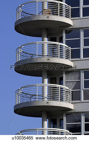 Stock Image of Round shaped balconies on the side of a residential.