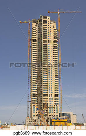 Stock Photograph of Tall residential tower block under.