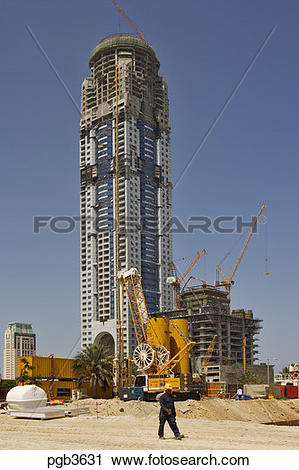 Stock Photography of Tall residential tower block under.