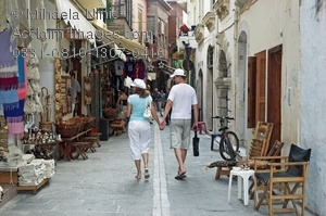 Stock Photo of a Tourists Walking Narrow Streets of Old Town.