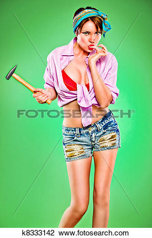 Stock Photo of Sensual girl licking fingers struck by hammer. Pin.