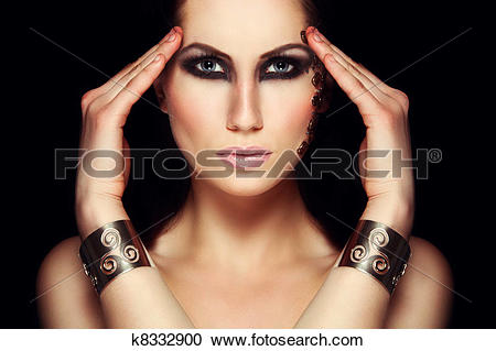 Stock Photography of Portrait of mystic woman with extravagant.