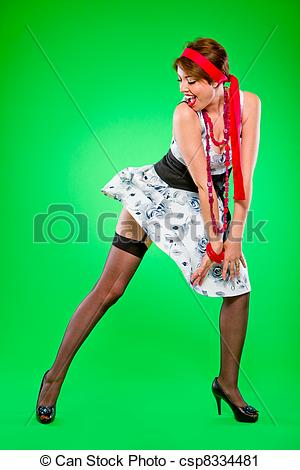 Stock Photography of Sexy woman looking on dress blown up by wind.