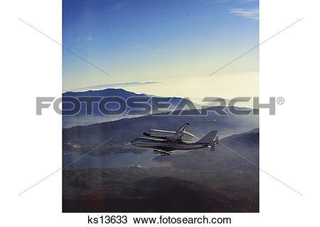 Stock Photo of Orbiter Columbia begins its return flight to.