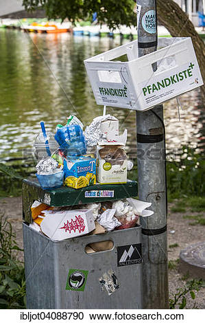 Stock Photography of Overflowing public rubbish bin, box for.