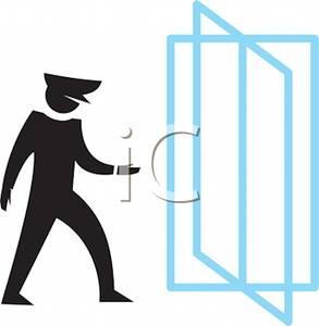 Man Walking Through a Revolving Door.