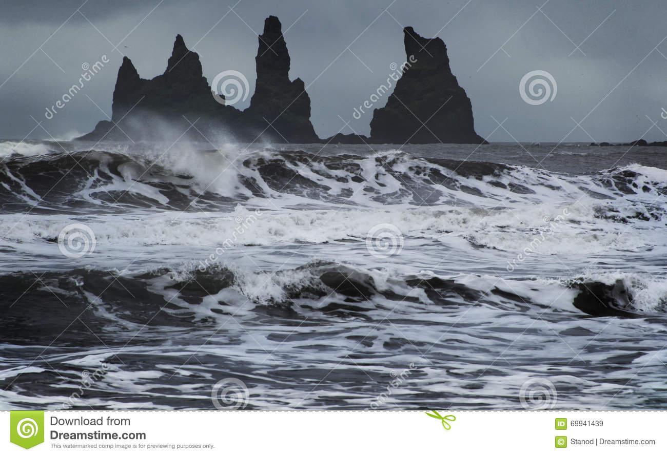 Reynisdrangar Cliffs In The Ocean, South Iceland Stock Photo.