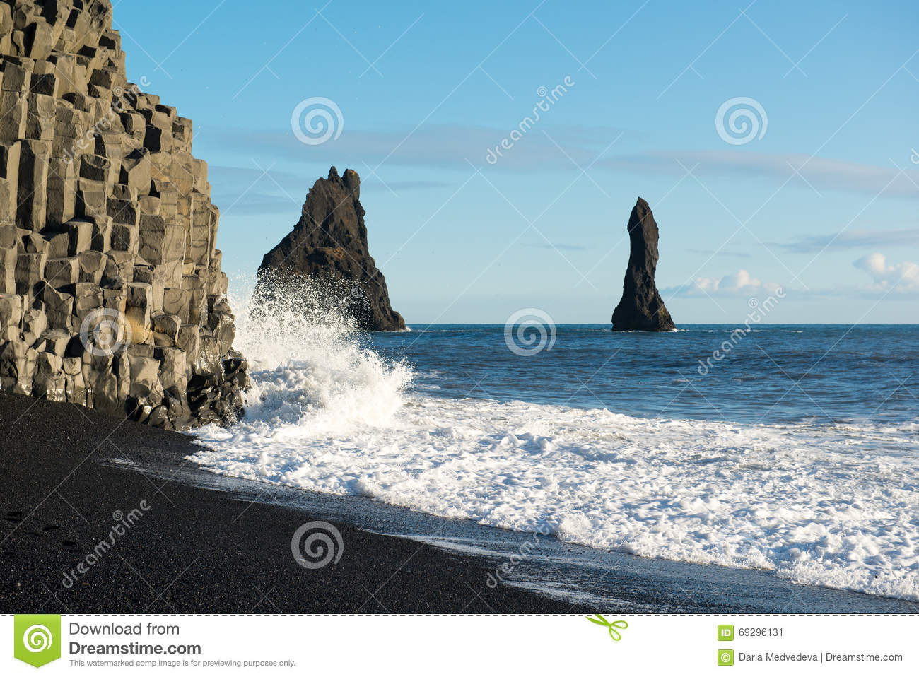 Black Sand Beach With Ocean Waves And Reynisdrangar Rocks At.