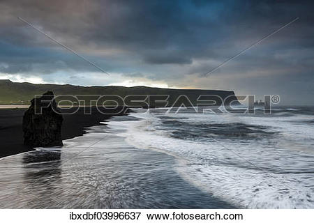 """Picture of """"Reynisdrangar rock formation, dramatic clouds, black."""
