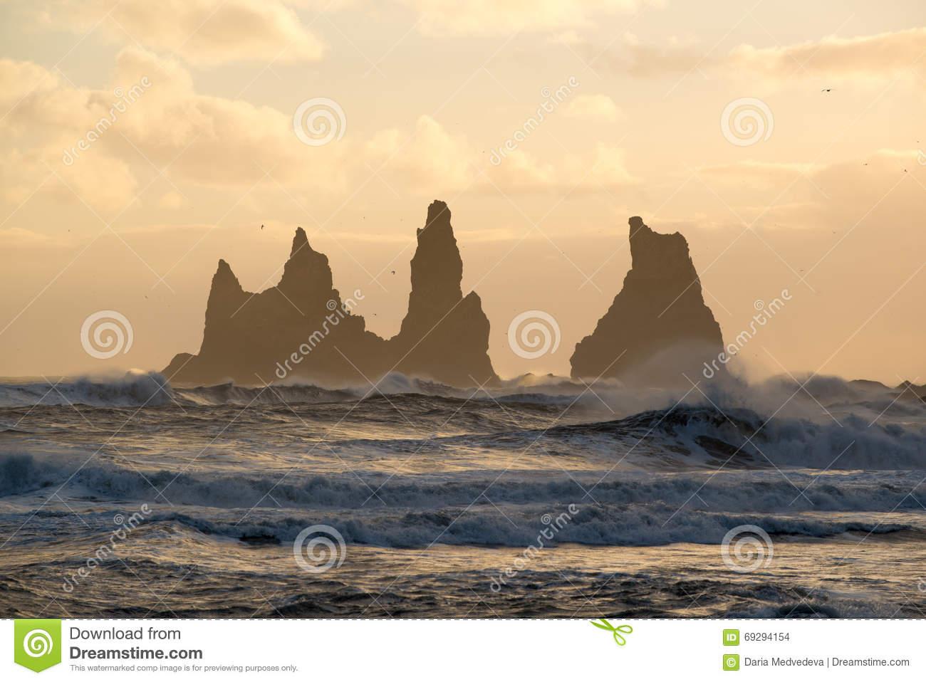 Sunset At Reynisdrangar Cliffs On Black Sand Beach In Vik, Iceland.