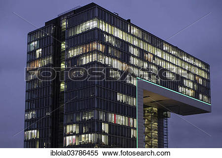 "Stock Image of ""Illuminated Kranhaus Mitte office building at dusk."