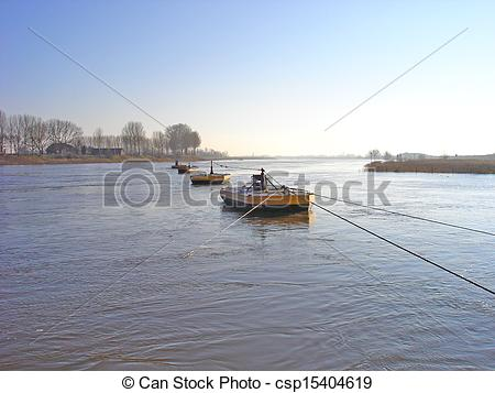 Stock Photography of Beaters of cable anchor of ferry in river.