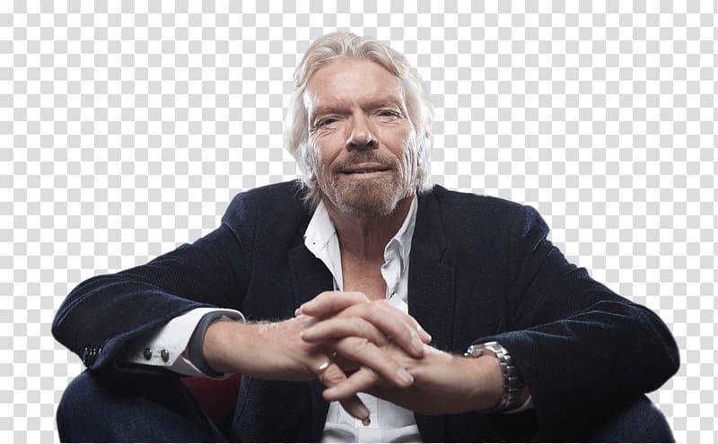 Man in black suit jacket, Richard Branson Sitting.
