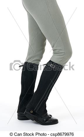 Stock Image of Woman wearing horse riding boots and breeches, on.