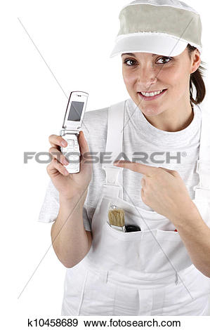 Stock Photograph of Female decorator waiting for the phone to ring.