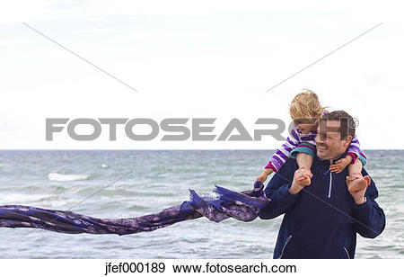 Stock Photograph of Danmark, Ringkoebing, little girl with her.