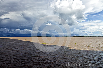 Meeting Rivers In Amazon Brazil Stock Photo.