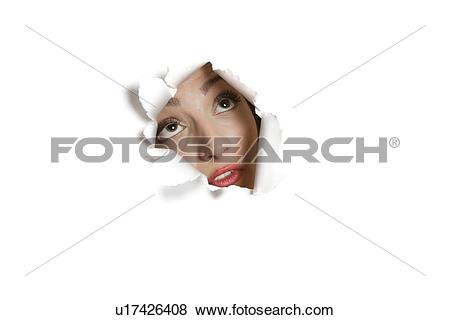 Pictures of Young Middle eastern woman looking up from ripped.